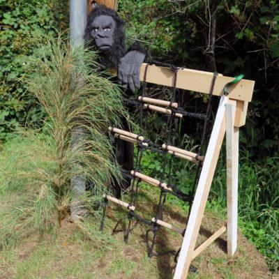 Gorilla guarding the cargo net climbing obstacle