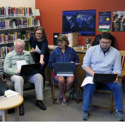 Website designer, Anneliese Dehner, teaching Bryan Grummon, Ali Van Otterloo, and Jeremy Skinner to update website
