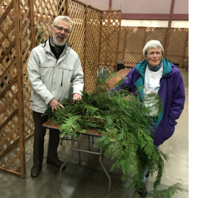 George and Donna deliver fresh Cedar boughs cut from their yard.