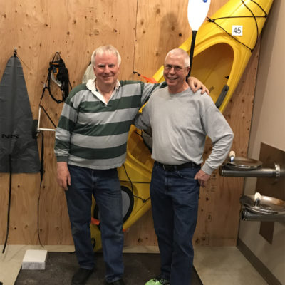 Bryan and Craig finish hanging the kayak