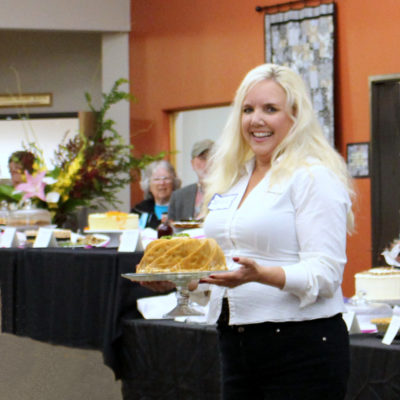 Jessica displays the desserts.