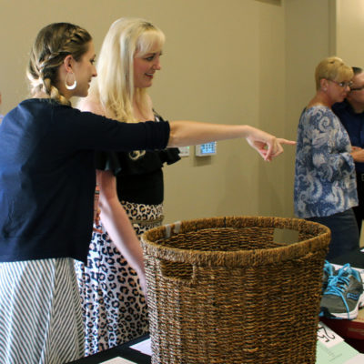 Potential bidders check out the silent auction items.