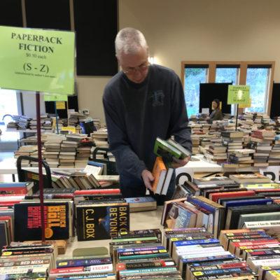Craig sorting hardback fiction.