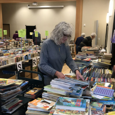 Terry sorting the Children's books.